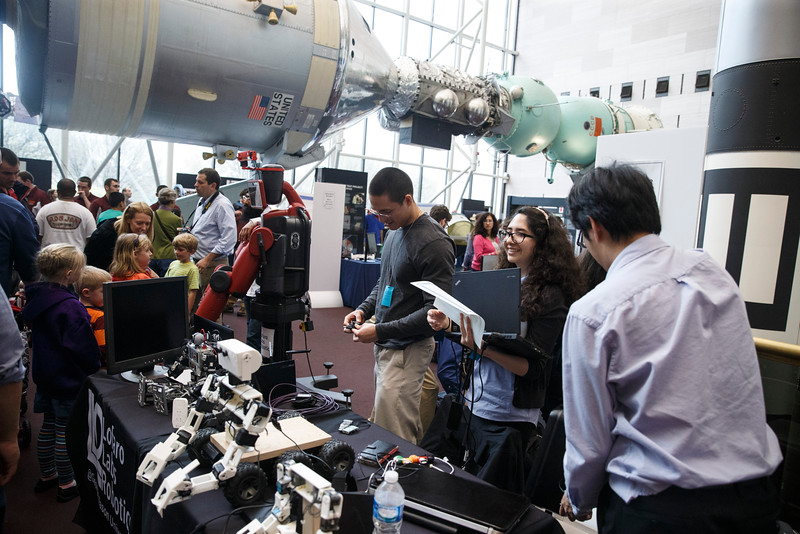 George Mason University students show off robots during the Smithsonian Robotics Exhibition at the Smithsonian National Air and Space Museum on April 3, 2015. Photo by Craig Bisacre/Creative Services/George Mason University