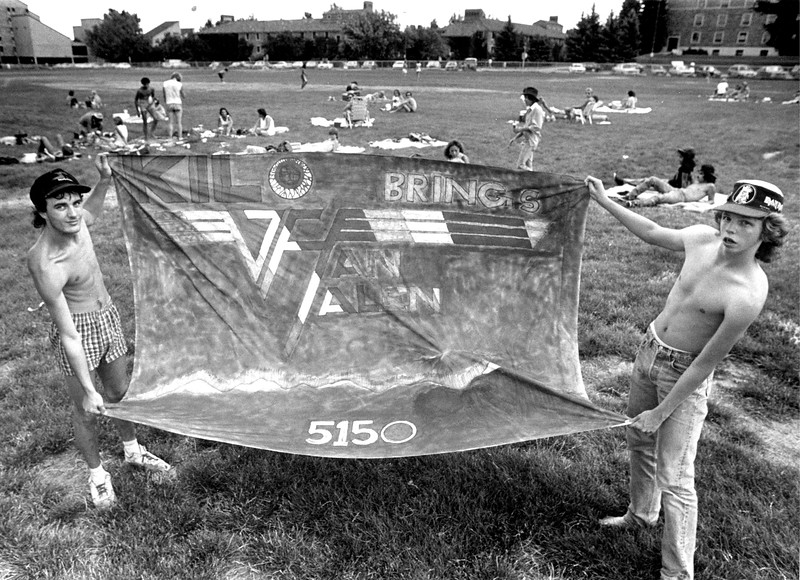 Fans on the CU Boulder Campus hold up a sign welcoming the band Van Halen for the 1986 Concert at Folsom Field.<br /> Daily Camera File Photo