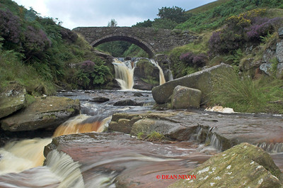 RIVER DOVE FLOWING UNDER PACKHORSE BRIDGE AT THREE SHIRES HEAD 0121