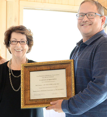 Kevin Harvison | Staff photo<br /> Picturef from left, Margaret Barton, presents the 2017 Realtor of the Year Award in appreciation of outstanding service to the Southeastern Oklahoma Association of Realtors, to Bill Chaney during the inaugural luncheon Thursday at the Putuerbaugh House.