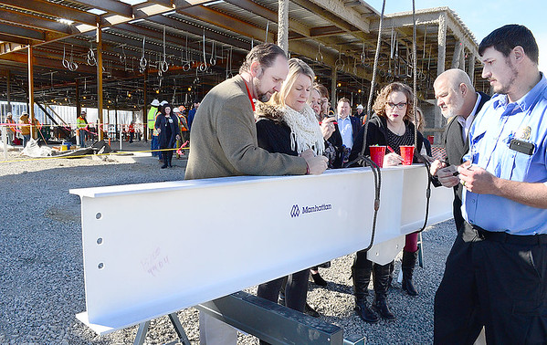 Kevin Harvison | Staff photo<br /> McAlester Regional Hospital Center employees and dignitaries signed the final beam to be placed on the Emergency Room project.