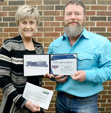 Kevin Harvison | Staff photo<br /> Pictured from left, Betty Balkman, Modern Woodmen presents Josh Hass with the Modern Woodmen's Hometown Heroes Award. Hass is being recognized for his efforts and countless hours of service to the community by Modern Woodmen of America members. A $100 grant will be given to Shared Blessings, the charitable organization of his choice.