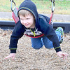Kevin Harvison | Staff photo<br /> Washington Early Childhood Center/Kibois Headstart student Kingston Shelton flys through the air during recess.