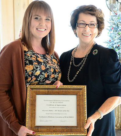 Kevin Harvison | Staff photo<br /> Cheyenne Dollins, left, is presented the 2017 Rookie of the Year in appreciation of outstanding service to the Southeastern Oklahoma Association of Realtors by Margaret Barton, during the inaugural luncheon Thursday at the Putuerbaugh House.
