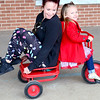 Kevin Harvison | Staff photo<br /> Washington Early Childhood Center/Kibois Headstart student Brynleigh Hackler, gives Holly Ledford a ride around during recess.