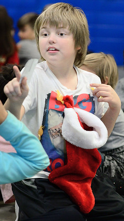 Kevin Harvison | Staff photo<br /> McAlester Elementary student Wrigley Sampson shows off his Christmas spirit with candy and stocking stuck to this shirt.