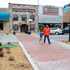 Kevin Harvison | Staff photo<br /> Pedestrians hurry across the new crosswalk at the corner of Choctaw Avenue and First Street.