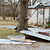 Kevin Harvison | Staff photo<br /> Debris from a second trailor home is photographed Tuesday morning near Adamson after winds from a thunderstorm roared through the area.