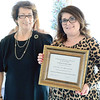Kevin Harvison | Staff photo<br /> Pictured from left, Margaret Barton, presents the 2017 Affiliate of the Year to Christie John, right, in appreciation of outstanding service to the Southeastern Oklahoma Association of Realtors at the Inaugural Luncheon Thursday at the Puterbaugh House.