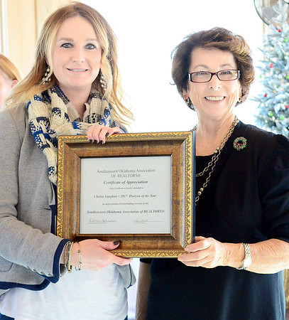 Kevin Harvison | Staff photo<br /> Chelsie Vaughan, left, is presented the 2017 Horizon of the Year Award in appreciation of outstanding service to the Southeastern Oklahoma Association of Realtors by Margaret Barton during the inaugural luncheon Thursday at the Putuerbaugh House.