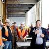 "Kevin Harvison | Staff photo<br /> McAlester Regional Hospital Center ACHE, Assistant Administrator Shawn Howard, center, speaks to the crowd before the start of the ""beam ceremony"" Friday for the new Emergency Room project."