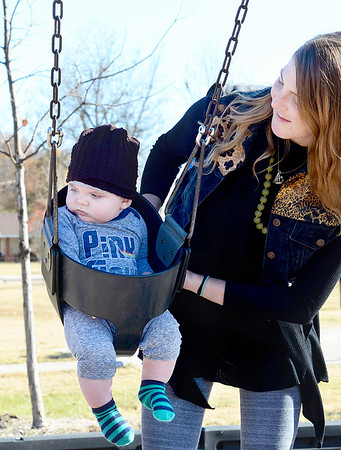 Kevin Harvison | Staff photo<br /> Whitney Bell, pushes her 5 month-old son Gus Bell at Chadick Park. The two where passing by from Fayetteville to Dallas and needed to stop and get out of their vehicle to stretch their legs and get some fresh air.