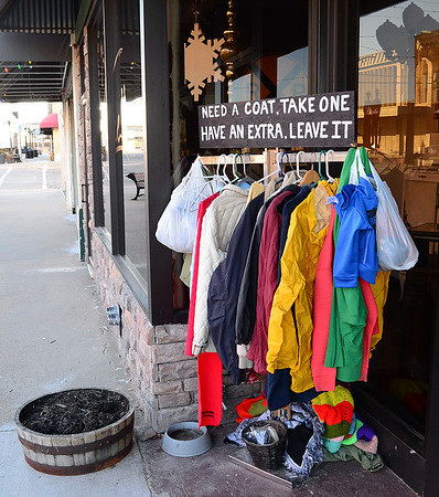Kevin Harvison | Staff photo<br /> Free coats are available on Choctaw Avenue near the Venue.