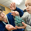 Kevin Harvison | Staff photo<br /> Washington Early Childhood Center/Kibois Headstart teacher Patti Salina works with Christian Tarullo preparing a Christmas decoration.