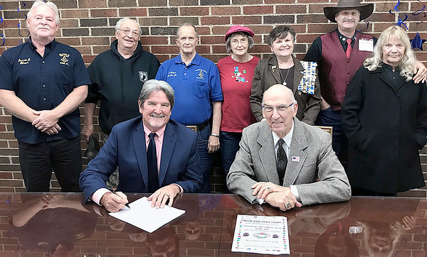 Kevin Harvison | Staff photo<br /> McAlester Mayor John Browne signed a proclamation naming Saturday December 16 as Wreaths Across America Day. A ceremony is schedualed for 11 a.m. at the south entrance of the Oak Hill Cemetery Dec. 11. McAlester Ammunition Plant Base Commander Colonel Joseph D. Blanding will be the speaker. The annual ceremony is being sponsored by Masonic District No. 27 AF & AM and the Kilihoti Champter of the DAR in conjunction with Wreaths Across America. Pictured seated from left, John Browne, mayor and Herb Hinton; and standing from left, Dennis Jay Wilson, Dave Bruno, Charles Thurber, Christina Thurber, Tammy Hinton, Paul Marean and Barbara Burke, Gold Star wife.