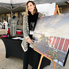 Kevin Harvison | Staff photo<br /> Choctaw Avenue block party volunteer Nicole Stufflebean show off the artist rendition of the revamped Choctaw Avenue.
