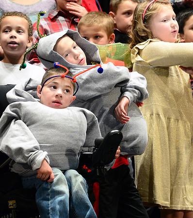 Kevin Harvison | Staff photo<br /> Students from Will Rogers Elementary perform in A Bugz Christmas Thursday night at S. Arch Thompson Auditorium.