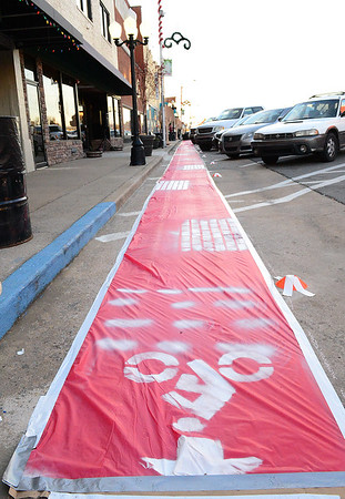 Kevin Harvison | Staff photo<br /> A Red vynle display showing where the future brick bike trail is planned for both side of Choctaw Avenue during the block party Thursday.