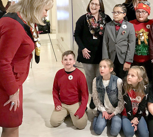 KEVIN HARVISON | Staff photo<br /> Oklahoma State Govoner Mary Fallon, left, visits with McAlester Public School students as she looks over the Christmas tree students from Emerson Elementary School decorated. The tree will be on dispaly inside the State Capitol. Students also participated in a special ceremony with Gov. Fallin and State School Superintendent Joy Hofmeister that lit the Capitol Christmas tree Tuesday night outside of the Capitol.