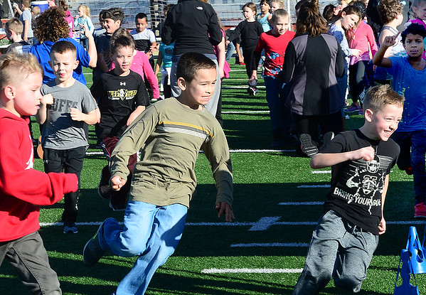 KEVIN HARVISON | Staff photo<br /> Will Rogers first and second grade students participate in the Buff Boogie Fun Run at Hook Eales Stadium Thursday. Pledges for the Will Roger students came in from 36 states and 6 different countries raising over $12,000 to date. The money would like to be used for new playground equipment and a track for students to use inside the fence for the schools Mile Club. Students from each Will Rogers grade will walk or run for an hour. Will Rogers School is working to lead the way in keeping students active as well as academic.