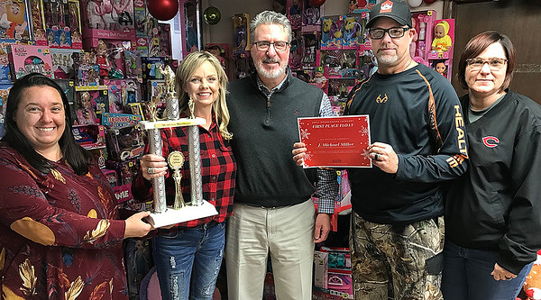 KEVIN HARVISON | Staff photo<br /> McAlester Christmas Parade first place entry winner for Small Business Category went to J. Michael Miller. Pictured from left, Christine Hermsmeyer, Executive Director for McAlester Main Street, Angie Miller, J. Michael Miller, Ryan Dalley and Sherri Dalley.