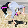 KEVIN HARVISON | Staff photo<br /> Jaylianna James, of Mcalester, shows off her athleticism as she does a back flip.