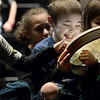 KEVIN HARVISON | Staff photo<br /> Gavan Auten, left checks out the drum as Kayden Copeland, center, shows his happiness in being selected to play the drum for the upcoming Christmas program.