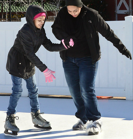 KEVIN HARVISON | Staff photo<br /> Maddyson Johnson, left, gets help skating from Tamrah Deo at the skating rink at the Farmer's Market in McAlester.