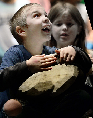 KEVIN HARVISON | Staff photo<br /> Kayden Copeland shows his excitement as he received his drum for the first time before the start of the Emerson Elementary School Christmas Program practice at S. Arch Thompson auditorium.