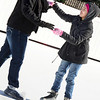 "KEVIN HARVISON | Staff photo<br /> Tamrah Deo, left, helps Maddyson Johnson while skating at the City of McAlester ""ice"" skating rink at the Farmers Market."