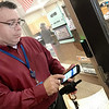 KEVIN HARVISON | Staff photo<br /> Raymond Wilson, KTC Assistant Director releases the school door locks from his phone Monday after the facility was on temporary lock down.