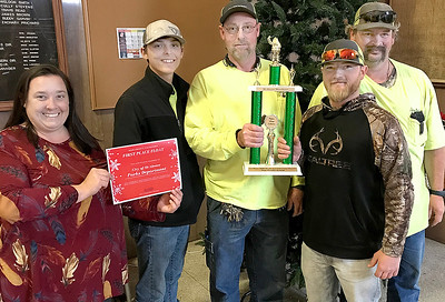 KEVIN HARVISON | Staff photo McAlester Parks Department was the winner of the McAlester Christmas Parade Non Profit Category. Pictured from left, Christine Hermsmeyer, Executive Director McAlester Main Street, Athiel Cozad, grounds keeper, Robbie Patton, head gardener, Lewis Beason, grounds Keeper and Cody Conner, grounds keeper.