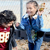KEVIN HARVISON | Staff photo<br /> Pictured from left, Jefferson Early Childhood Center students, Braylon Hernandez, left runs from Henry Walters after he retaliates with a bombardment of leaves.