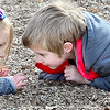 KEVIN HARVISON | Staff photo<br /> Jefferson Early Childhood Center students Callie Hollnd, left and Liam Turner, right, think they might have found the perfect rock during a recent recess.