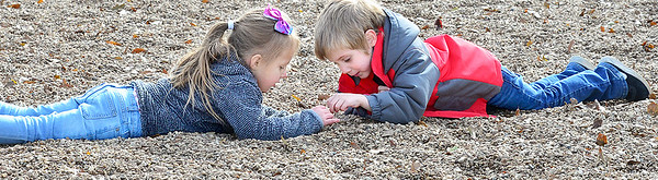 KEVIN HARVISON | Staff photo<br /> Jefferson Early Childhood Center students Callie Hollnd, left and Liam Turner, right, look for the perfect rock during a recent recess.