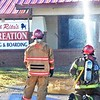 KEVIN HARVISON | Staff photo<br /> A fire destroyed Pet Creation at 400 West Carl Albert Parkway Friday morning.