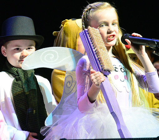 KEVIN HARVISON | Staff photo<br /> Jake McNatt, left as the Snowman and Holly Grilliot, right sings as the Tooth Fairy during the Will Rogers Christmas Program at S. Arch Thompson Auditorium.
