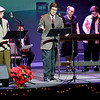 KEVIN HARVISON | Staff photo<br /> Members of the McAlester High School Competitive Speech, Theatre and Mock Trial clubs perform A Christas Carrol A LIve Radio Play Friday night at S. Arch Thompson Auditorium.