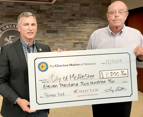 "KEVIN HARVISON | Staff photo<br /> The Choctaw Nation of Oklahoma presented the Cityof McAlester with a 4th quarter check for the Choctaw Community Partner Fund Monday at the McAlester Community Center witht he sum of $11,200. Pictured from left Robert Karr, Choctaw District 11 Councilman and McAlester City Manager Pete Stasiak. The Choctaw Nation is the third largest Indian Nation in the United States, with close to 200,000 tribal members. The first tribe over the Trail of Tears, the historic boundaries are in the southeast corner of Oklahoma. The vision of the Choctaw Nation is ""To achieve healthy, successful, productive, and self-sufficient lifestyles for a proud nation of Choctaws."" Tribal business success over the past few years has enabled the Choctaw Nation to begin to achieve this vision, as well as to assist the communities that are in the Choctaw Nation. Faith, Family and Culture are important values to Choctaw people. For more information about the Choctaw Nation, its culture, heritage and traditions, please go to  <a href=""http://www.choctawnation.com"">http://www.choctawnation.com</a>."