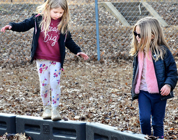 KEVIN HARVISON | Staff photo<br /> Out for a recess stroll, Jefferson Early Childhood Center students Journee McElhany, left and Keirsten Shipley enjoy the weather during a recent recess.