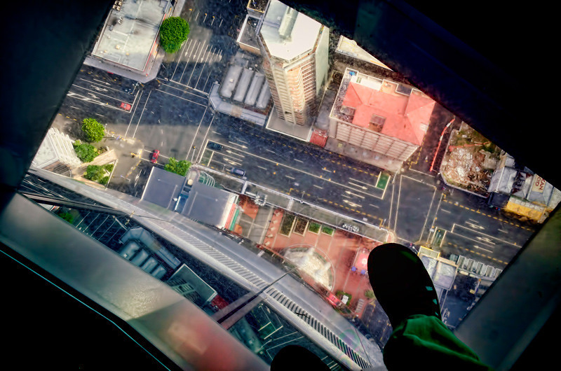 Lookng down the glass floor of the Sky Tower in Aucklan, New Zealand.