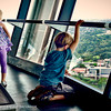 Children fascinated by the view at the Sky Tower observation deck in Auckland, New Zealand.
