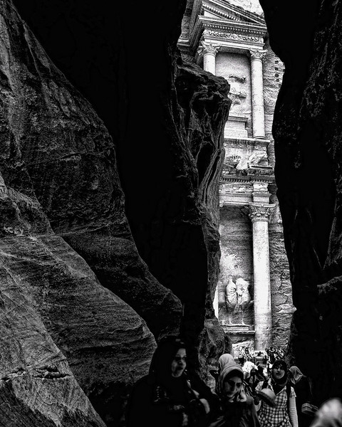 The narrow opening between the rocks reveal the ancient city of Petra, Jordan.