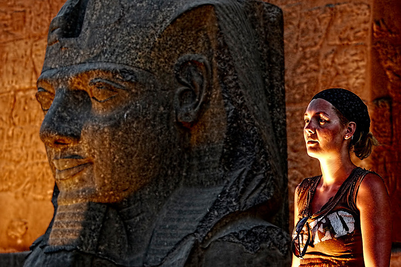 Princess Nefertiti's head and a tourist posing against it. Spotted in Luxor, Egypt.