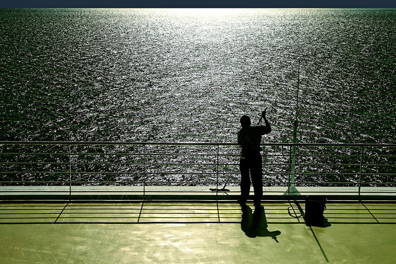 A hard working shiphand, always cleaning the ship, morning, noon and night. Photo taken in Mazatlan, Mexico.