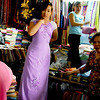 A young woman modeling the clothes they sell at Benh Thanh public market, Ho Chi Min City, Vietnam.