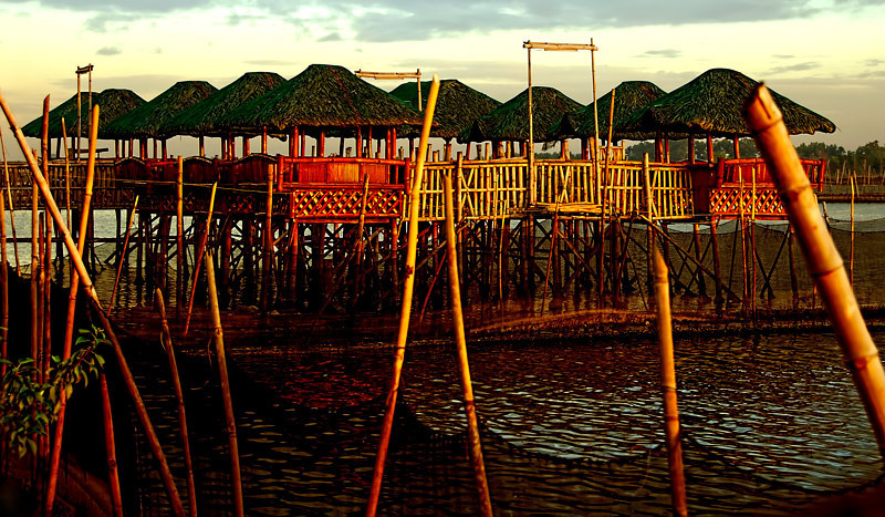 Another view of the dining cabanas as the sun rises over the fishponds in Dampalit, Metro-Manila, Philippines.