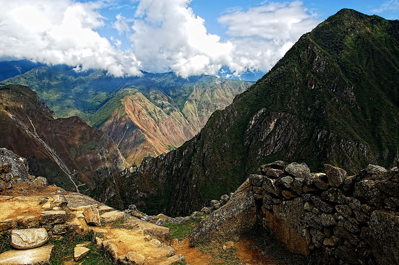 """A view at the top of the """"old Peak"""" in Macchu Picchu, Peru. From here you can see unique views of the Andes and the Urubamba jungle below."""