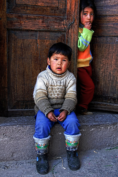 Two Peruvian children looks at me, so perplexed as I ask them in Spanish if they have a bathroom. Taken in a small town at the high plains of Peru on our way to Lake Titicaca.