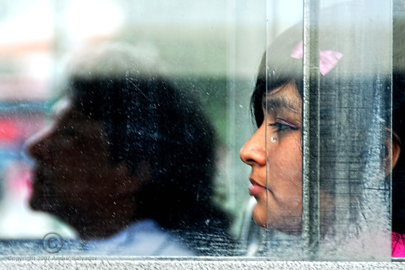 While stopped in city traffic, I noticed this face from another bus across us. Photo taken in Lima, Peru.